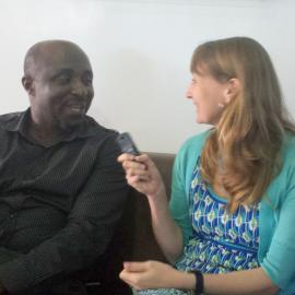SPARQ executive director alana conner interviews a man in west africa