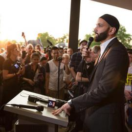 An Imam speaks to a crowd