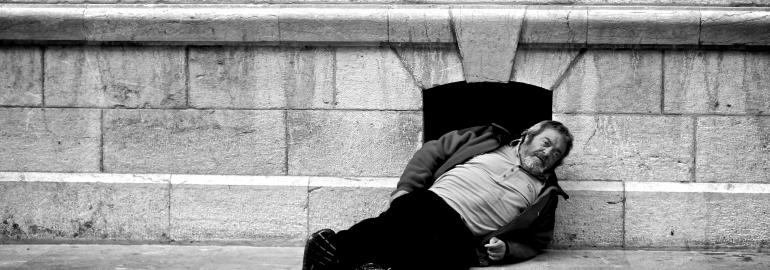 Man laying on the ground in need of help